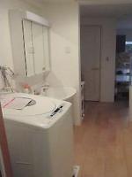 洗面空間もキレイに納まり、玄関も拡張しました